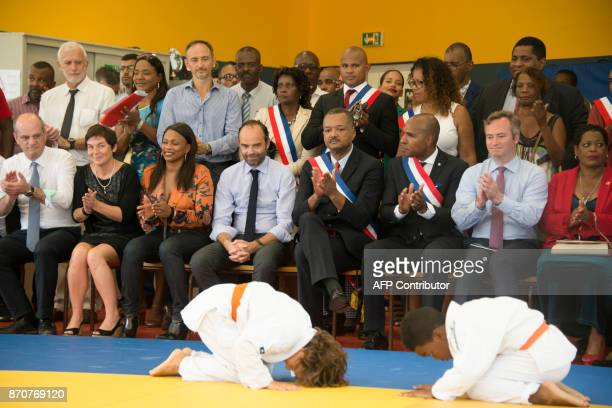 France's Prime Minister Edouard Philippe sitted next to MP Olivier Serva and mayor of Les Abymes Eric Jalton attends a judo class as he inaugurates...
