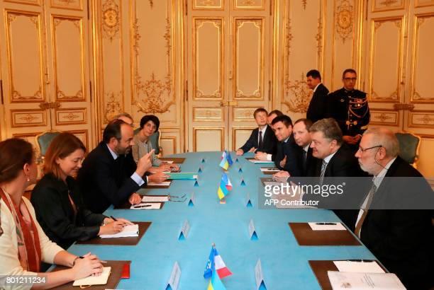 France's prime minister Edouard Philippe speaks with Ukraine's president Petro Poroshenko on June 26 2017 at the Hotel Matignon in Paris President...