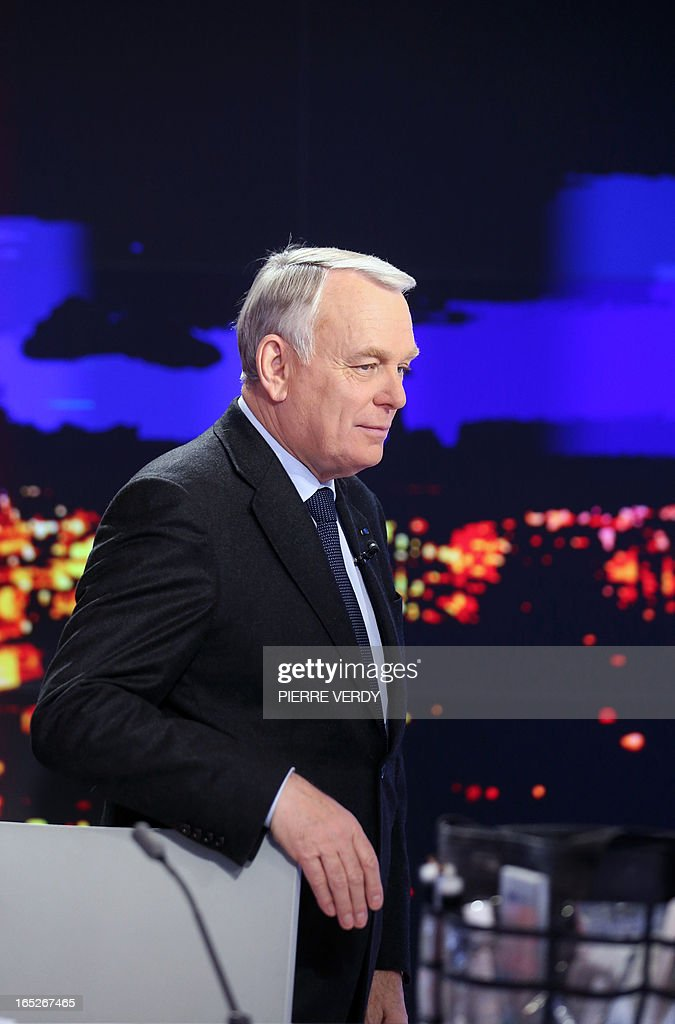 France's Prime minister Jean-Marc Ayrault arrives to take part in the broadcast news of France 2 TV channel on April 2, 2013. France's ex-budget minister Jerome Cahuzac was charged today in a tax fraud probe after he admitted having a foreign bank account, dealing a fresh blow to President Francois Hollande's embattled government.