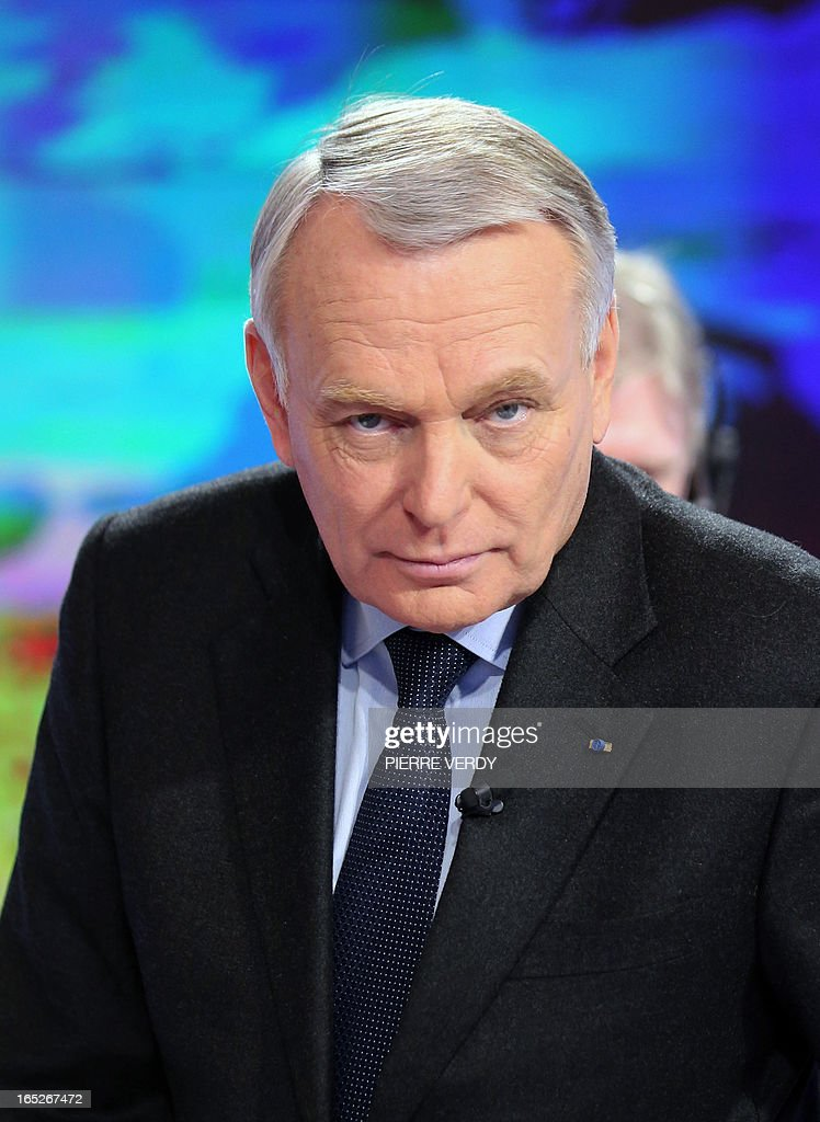 France's Prime minister Jean-Marc Ayrault arrives to take part in the broadcast news of France 2 TV channel on April 2, 2013. France's ex-budget minister Jerome Cahuzac was charged today in a tax fraud probe after he admitted having a foreign bank account, dealing a fresh blow to President Francois Hollande's embattled government. AFP PHOTO PIERRE VERDY