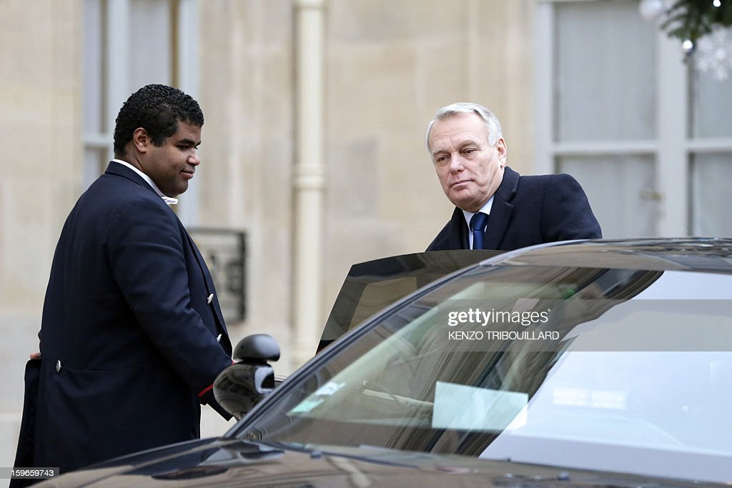 France's Prime minister Jean-Marc Ayrault leaves the Elysee presidential Palace on January 18, 2013 in Paris after attending a fifth Defence Council since French forces back the Malian army against Islamist rebels.
