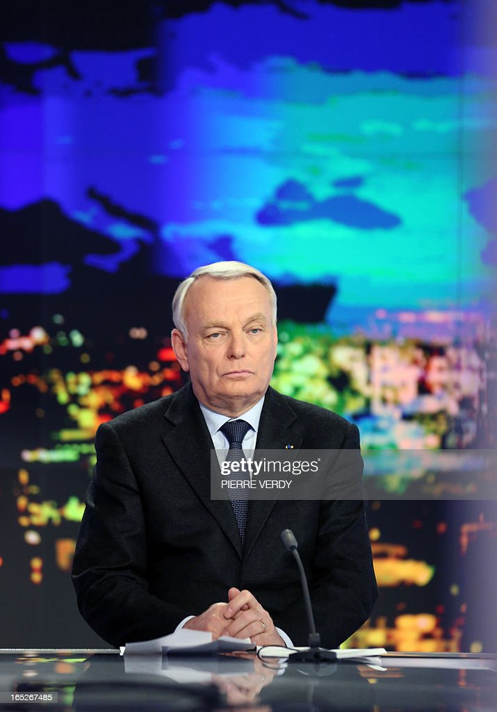 France's Prime minister Jean-Marc Ayrault looks on before taking part in the broadcast news of France 2 TV channel on April 2, 2013. France's ex-budget minister Jerome Cahuzac was charged today in a tax fraud probe after he admitted having a foreign bank account, dealing a fresh blow to President Francois Hollande's embattled government.