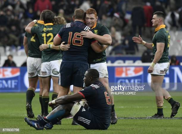 France's prop Daniel Kotze embraces South Africa's Steven Kitshoff after the friendly rugby union international Test match between France and South...