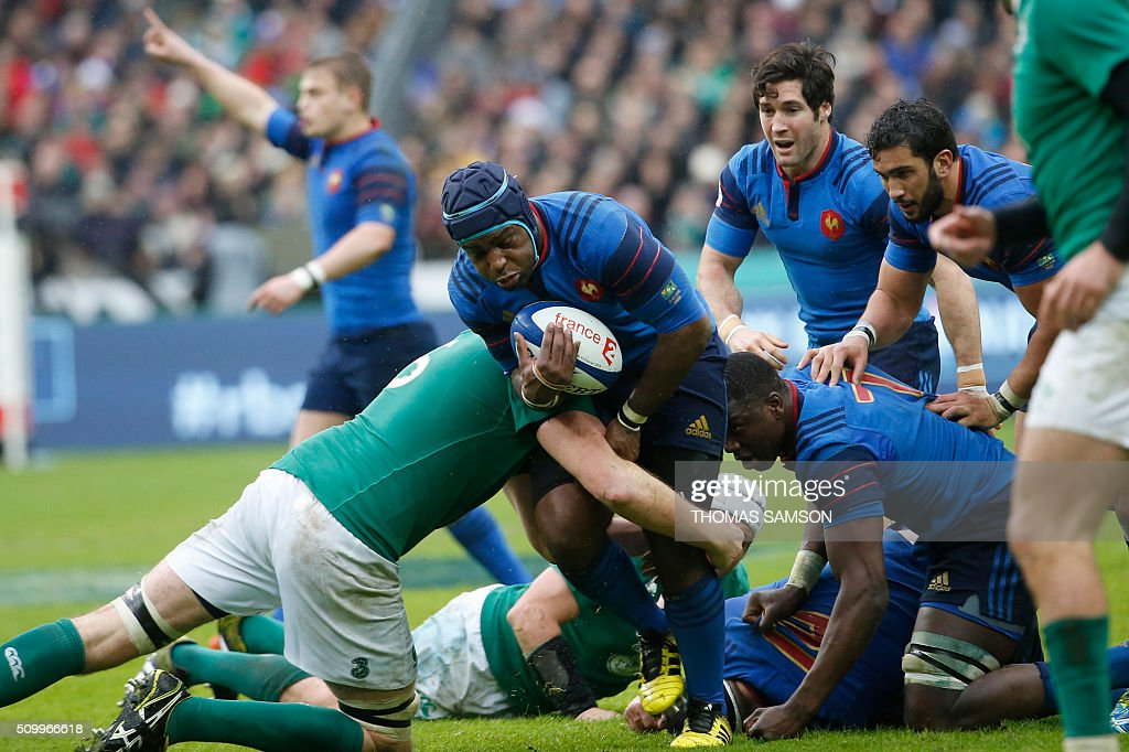 France's prop Eddy Ben Arous (C) is tackled during the Six Nations international rugby union match between France and Ireland at the Stade de France Stadium in Saint-Denis, north of Paris, on February 13, 2016. AFP PHOTO / THOMAS SAMSON / AFP / THOMAS SAMSON