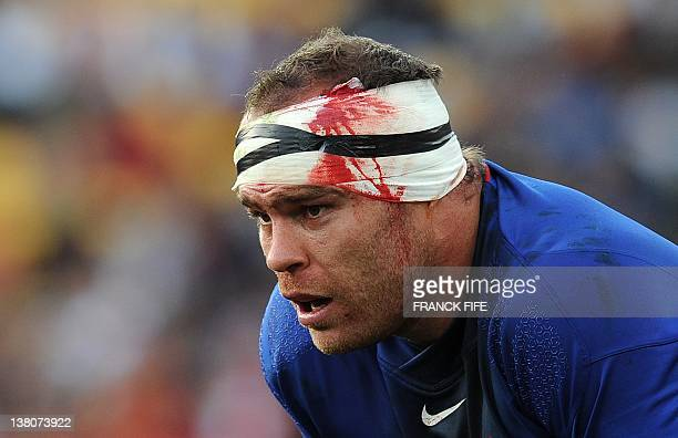 France's prop JeanBaptiste Poux bleeds from a head wound during the 2011 Rugby World Cup pool A match France vs Tonga at the Wellington Regional...