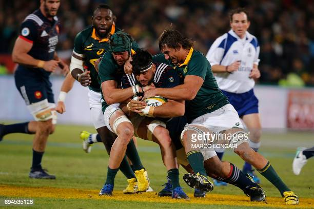 France's prop Rabah Slimani is tackled by South Africa's lock Eben Etzebeth and South Africa's prop Francois Malherbe during the first rugby union...