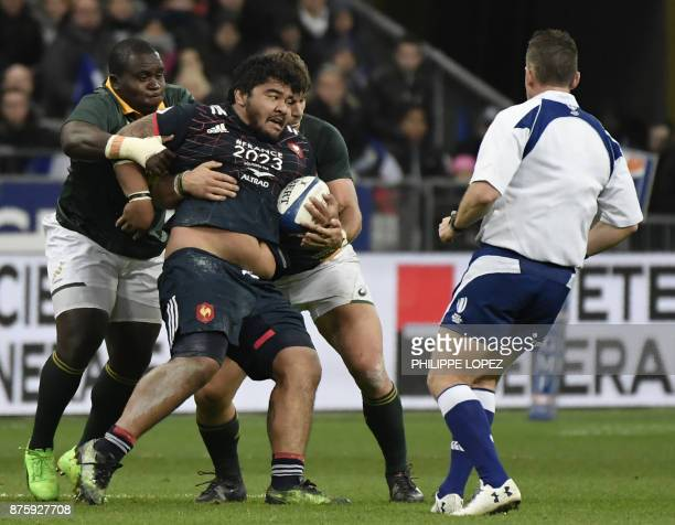 France's prop Sébastien Taofifenua is tackled during the friendly rugby union international Test match between France and South Africa's Springboks...