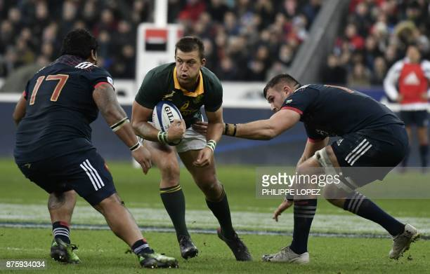 France's prop Sébastien Taofifenua tackles South Africa's flyhalf Handre Pollard during the friendly rugby union international Test match between...