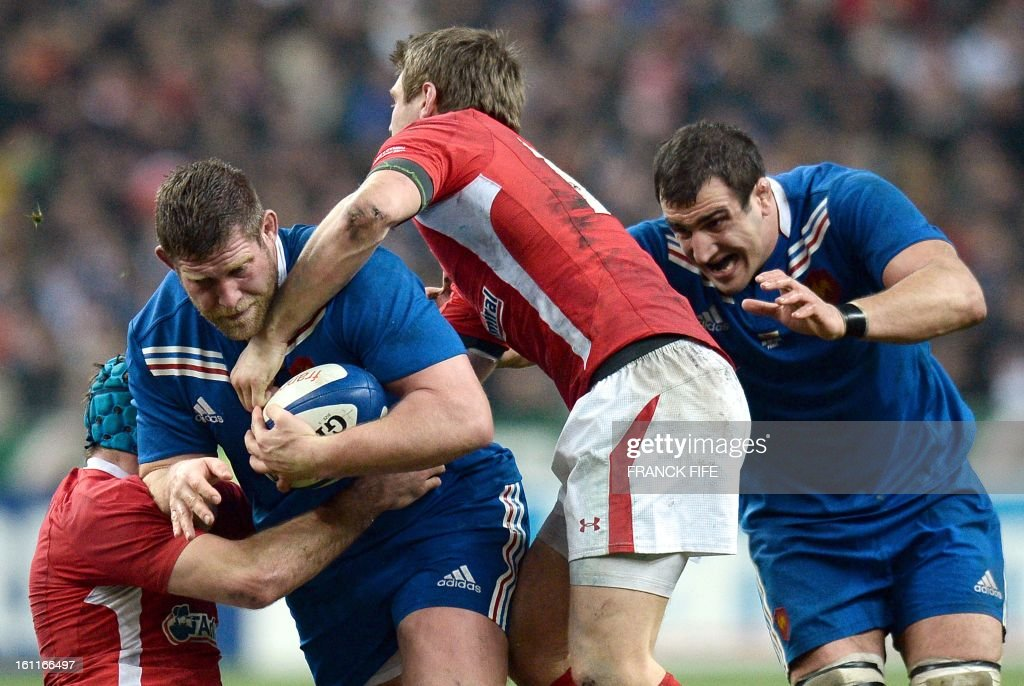 France's prop Vincent Debaty (R) runs with a ball next to Wale's scrum half Mike Phillips (C) and France's lock Yoann Maestri (R) during the Six Nations Rugby Union match between France and Wales at the Stade de France on February 9, 2013 in Saint-Denis, north of Paris.