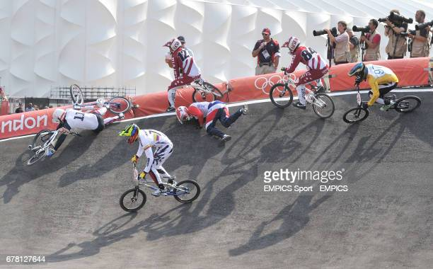 France's Quentin Caleyron crashes bringing down USA's Connor Fields and Netherlands Raymon van der Biezen on the the first corner during the first...