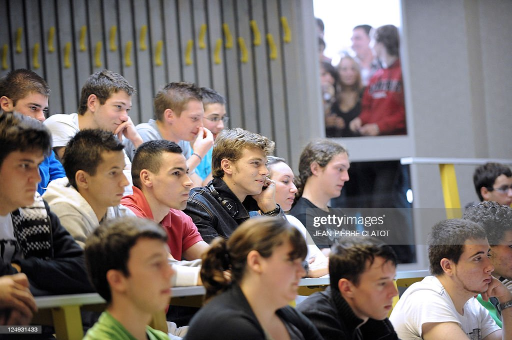 France's record-holder sprinter Christophe Lemaitre (4thL, 2nd row) attends a lecture with classmates on September 8, 2011 at the University of Savoie in the French Alpine town of Annecy-le-Vieux, in the Savoie region. Lemaitre is enrolled in Annecy's IUT (French Institute of Technology University) to graduate in Electrical Engineering and Industrial Computing, with track-and-field as second major.