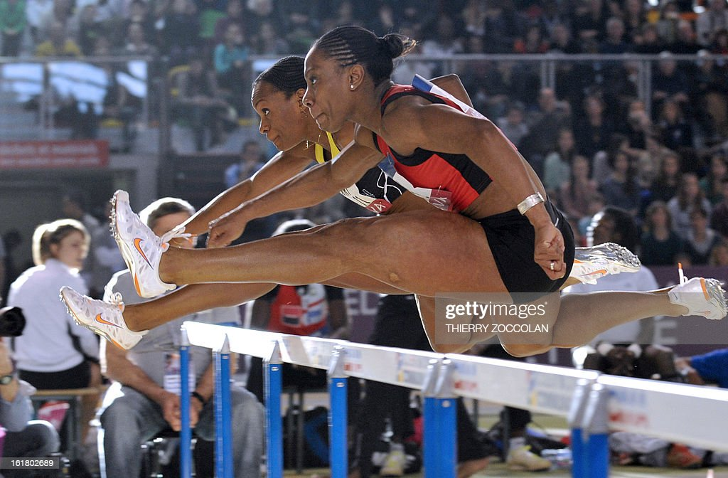 France's Reina-Flor Okori (L) and France's Alice Decaux (R) compete in the women's 60m hurdles contest at the 2013 French Indoor Athletics championships on February 16, 2013 in Aubiere, central France. ZOCCOLAN