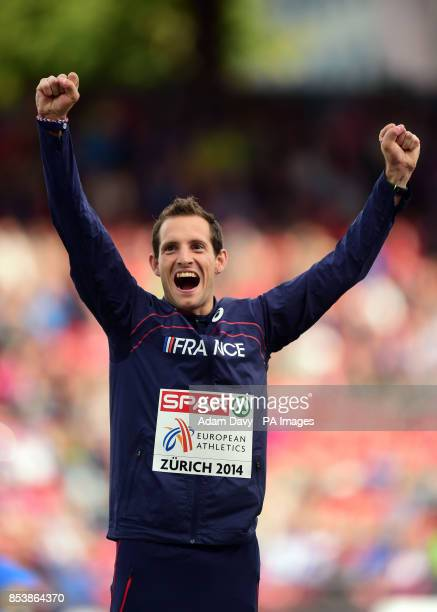 France's Renaud Lavillenie celebrates his Gold medal in the Men's Pole Vault Final during day five of the 2014 European Athletics Championships at...
