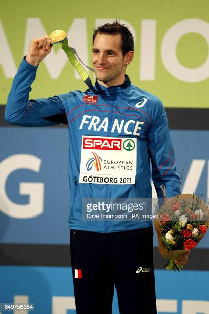 France's Renaud Lavillenie poses with his gold medal on the podium after winning the Pole Vault Men's Final