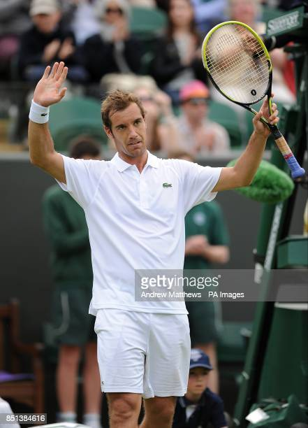 France's Richard Gasquet celebrates after victory against Spain's Marcel Granollers during day two of the Wimbledon Championships at The All England...