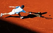 France's Richard Gasquet defeats Italy's Daniele Bracciali in their first round match of the French Open tennis tournament at Roland Garros stadium...