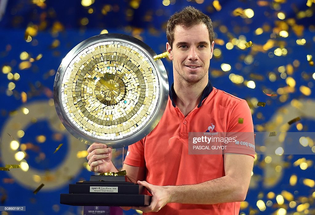 France's Richard Gasquet poses with his trophy after winning the final tennis match of the ATP World Tour Open Sud de France in Montpellier, southern France, on February 7, 2016. Richard Gasquet won the Montpellier ATP title for the third time on Sunday with a 7-5, 6-4 win over French compatriot Paul-Henri Mathieu. / AFP / PASCAL GUYOT