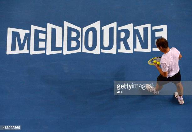 France's Richard Gasquet prepares to serve against Spain's Tommy Robredo during their men's singles match on day five of the 2014 Australian Open...