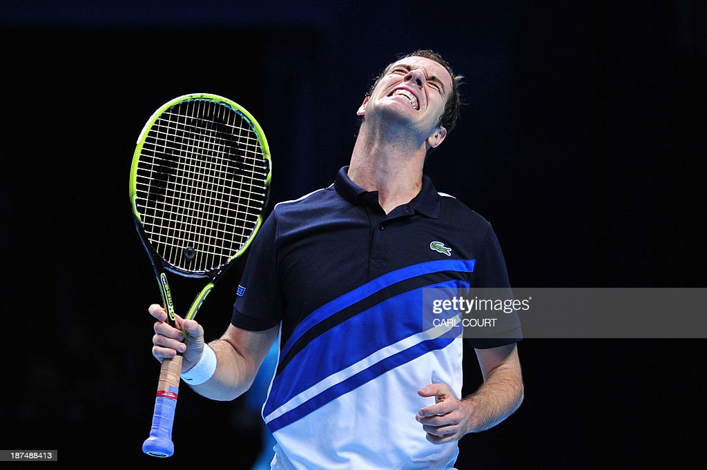 France's Richard Gasquet reacts after netting a return against Serbia's Novak Djokovic during their group B singles match in the round robin stage on the sixth day of the ATP World Tour Finals tennis tournament in London on November 9, 2013.