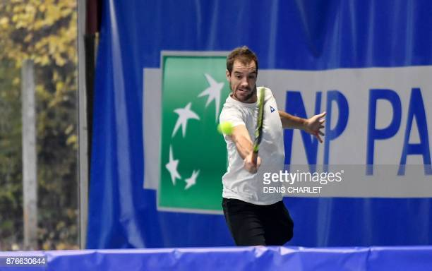 France's Richard Gasquet returns a ball during a training of France team players in Marcqen Baroeul northern France ahead of the Davis Cup final...