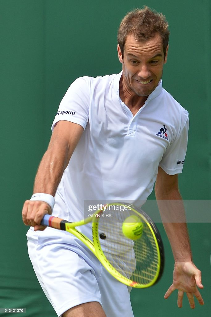 France's Richard Gasquet returns against Britain's Aljaz Bedene during their men's singles first round match on the second day of the 2016 Wimbledon Championships at The All England Lawn Tennis Club in Wimbledon, southwest London, on June 28, 2016. / AFP / GLYN
