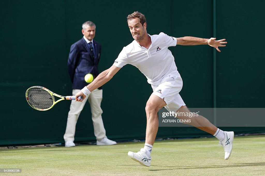 France's Richard Gasquet returns against Spain's Marcel Granollers during their men's singles second round match on the fourth day of the 2016 Wimbledon Championships at The All England Lawn Tennis Club in Wimbledon, southwest London, on June 30, 2016. / AFP / ADRIAN