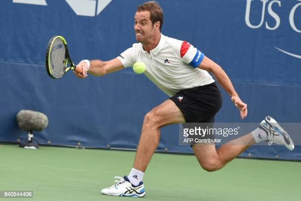 France's Richard Gasquet returns the ball to Argentina's Leonardo Mayer during their Qualifying Men's Singles match at the 2017 US Open Tennis...