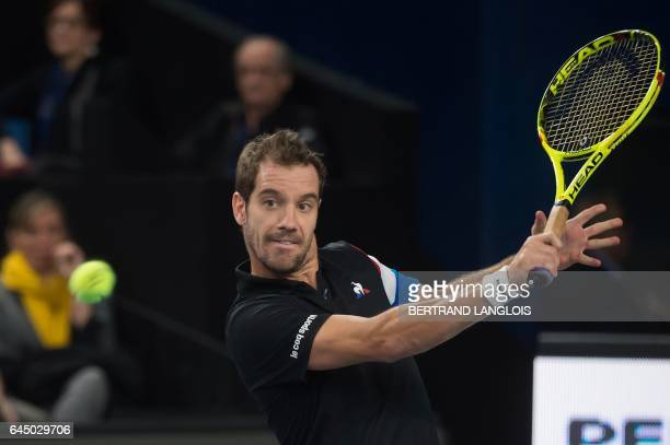 France's Richard Gasquet returns the ball to France's Gael Monfils during the ATP Marseille Open 13 tennis match in Marseille southern France on...