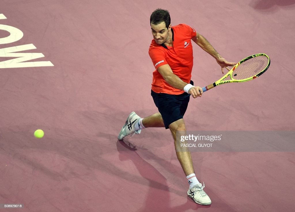 France's Richard Gasquet returns the ball to France's Paul-Henri Mathieu during the final tennis match at the ATP World Tour Open Sud de France in Montpellier, southern France, on February 7, 2016. / AFP / PASCAL GUYOT