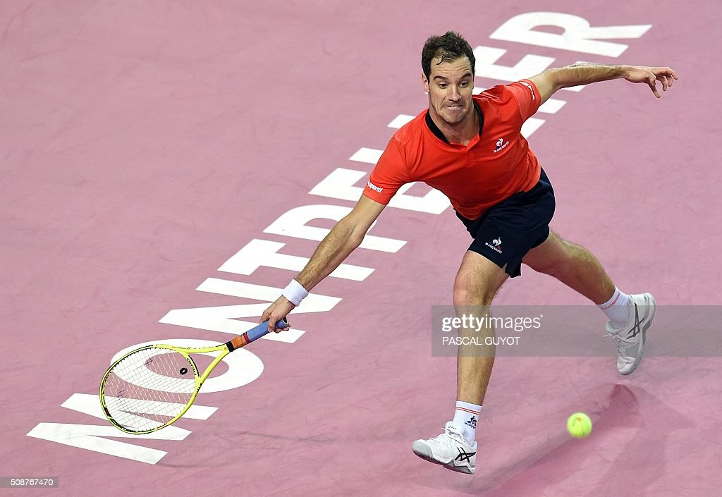 France's Richard Gasquet returns the ball to Germany's Dustin Brown during their semi-final tennis match at the Open Sud de France ATP World Tour in Montpellier, southern France, on February 6, 2016. / AFP / PASCAL GUYOT
