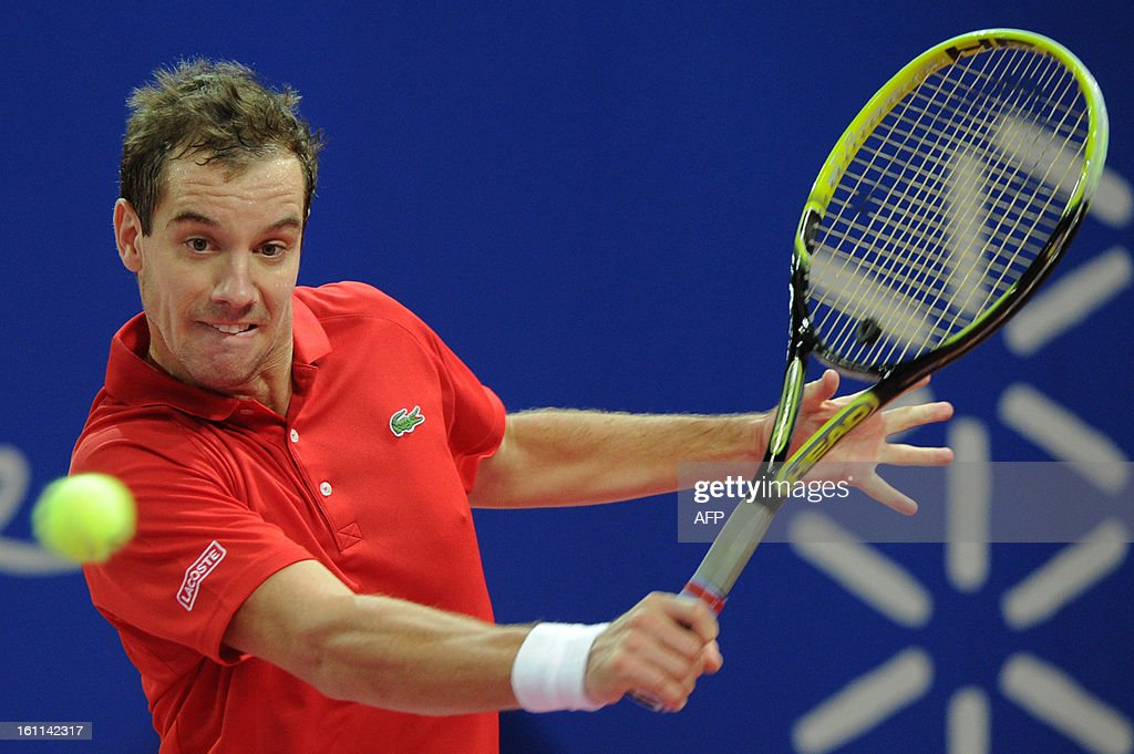 France's Richard Gasquet returns the ball to his Finnish opponent Jarkko Nieminen during the Open Sud de France world tour ATP Series semi final tennis match, on February 9, 2013 in Montpellier southern France. Gasquet won the match.