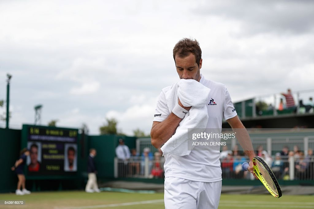 France's Richard Gasquet returns to his seat in a break between games against Spain's Marcel Granollers during their men's singles second round match on the fourth day of the 2016 Wimbledon Championships at The All England Lawn Tennis Club in Wimbledon, southwest London, on June 30, 2016. / AFP / ADRIAN