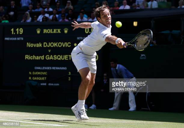 France's Richard Gasquet returns to Serbia's Novak Djokovic during their men's semifinal match on day eleven of the 2015 Wimbledon Championships at...