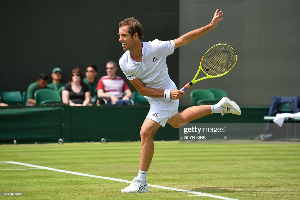 France's Richard Gasquet serves against Britain's Aljaz Bedene during their men's singles first round match on the second day of the 2016 Wimbledon Championships at The All England Lawn Tennis Club in Wimbledon, southwest London, on June 28, 2016. / AFP / GLYN