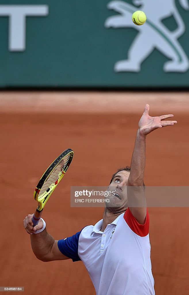 France's Richard Gasquet serves the ball to Australia's Nick Kyrgios during their men's third round match at the Roland Garros 2016 French Tennis Open in Paris on May 27, 2016. / AFP / Eric FEFERBERG