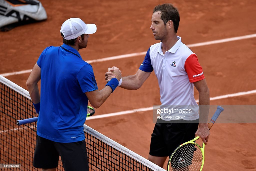 France's Richard Gasquet shakes hands with US player Bjorn Fratangelo after their men's second round match against at the Roland Garros 2016 French Tennis Open in Paris on May 25, 2016. / AFP / PHILIPPE