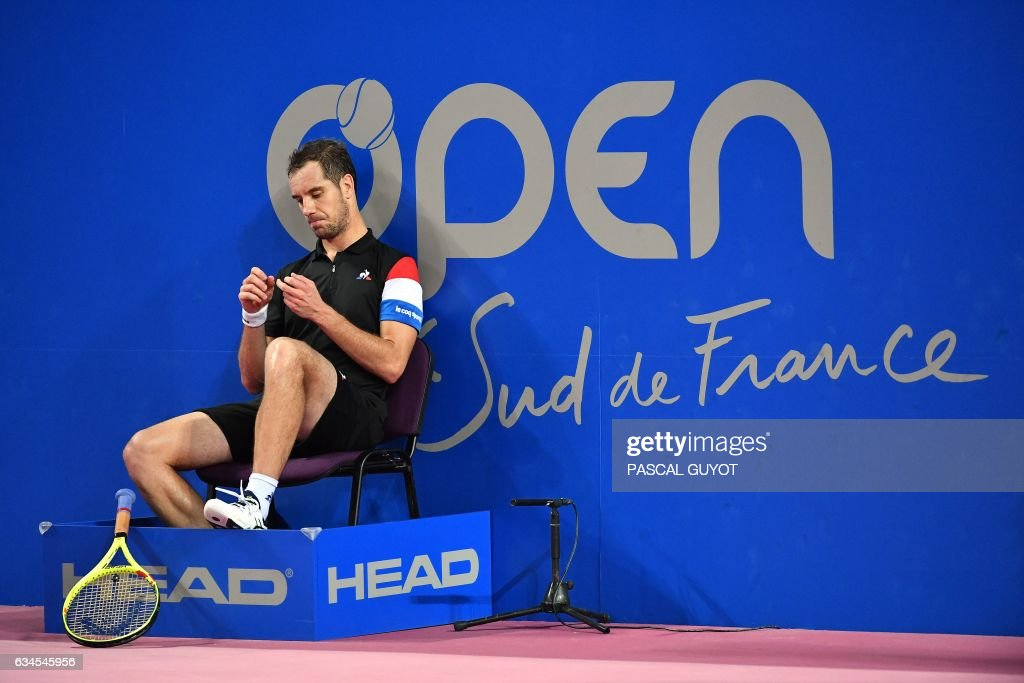 France's Richard Gasquet sits during his tennis match against France's Kenny de Schepper during the Open Sud de France ATP World Tour in Montpellier, southern France, on February 10, 2017. /