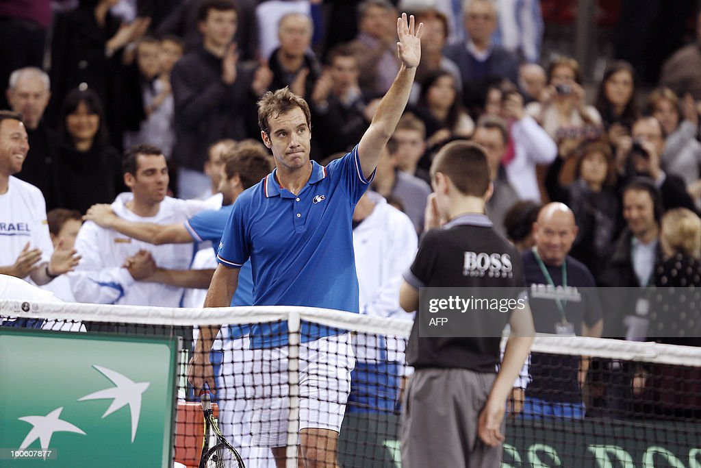 France's Richard Gasquet (L) waves the crowd after winning his tennis match of the Davis Cup against Israel's Amir Weintraub at the Kindarena stadium in Rouen on February 3, 2013. Gasquet won 6-4, 6-3.