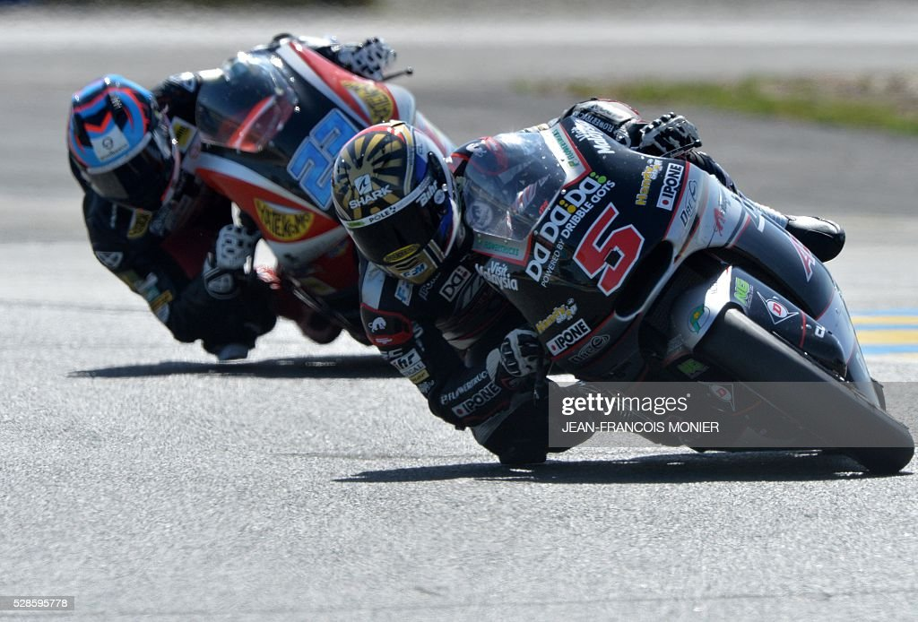 France's rider Johan Zarco (R) competes on his Kalex Ajo Motorsport N��5 ahead German's rider Marcel Schrotter on his Kalex AGR Team N��23 during a moto2 free practice session, ahead of the French motorcycling Grand Prix, on May 6, 2016 in Le Mans, northwestern France. / AFP / JEAN