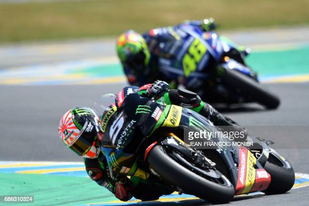 France's rider Johann Zarco competes on his Monster Yamaha TECH 3 MOTOGP N°5 ahead of Italy's rider Valentino Rossi on his Movistar Yamaha MOTOGP...