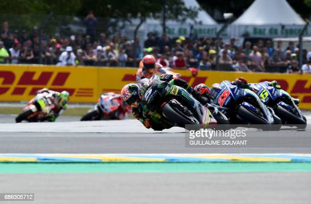 France's rider Johann Zarco on his Monster Yamaha TECH 3 MOTOGP N°5 competes ahead Spanish's rider Maverick Vinales on his Movistar Yamaha MOTOGP...