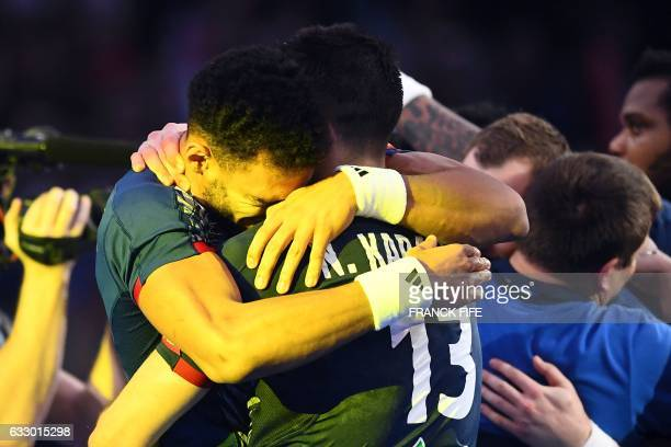 TOPSHOT France's right back Adrien Dipanda embraces France's centre back Nikola Karabatic after France won the 25th IHF Men's World Championship 2017...