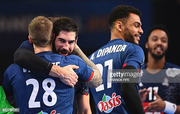 TOPSHOT France's right back Valentin Porte France's centre back Nikola Karabatic and France's right back Adrien Dipanda celebrate after France won...