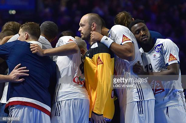 France's right wing Luc Abalo France's goalkeeper Vincent Gerard and their teammates gather during the 25th IHF Men's World Championship 2017 Group A...
