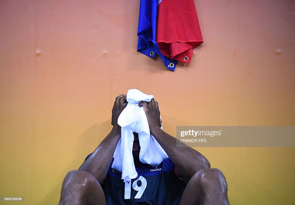 TOPSHOT France's right wing Luc Abalo reacts after France lost the men's Gold Medal handball match Denmark vs France for the Rio 2016 Olympics Games...