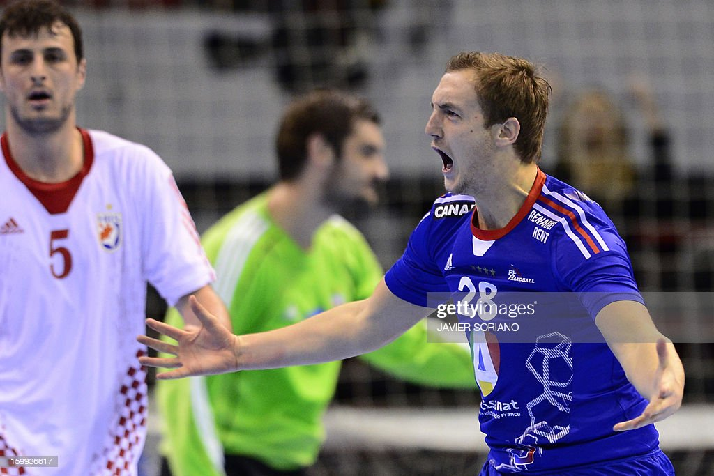 France's right wing Valentin Porte celebrates after scoring during the 23rd Men's Handball World Championships quarterfinal match France vs Croatia...
