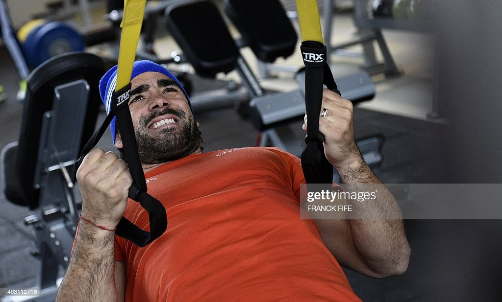France's right wing Yoann Huget grimaces during an indoor training session on February 10, 2015 in Marcoussis, south of Paris, as part of the preparation of the Six Nations rugby tournament. France will play Ireland in their 2015 Six nations' rugby match in Dublin on February 14, 2015.