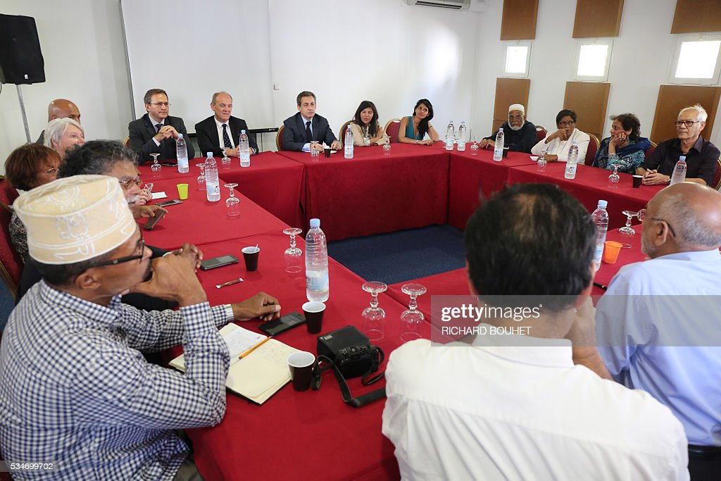 France's right-wing Les Republicains (LR) party president Nicolas Sarkozy (R) is pictured during a meeting with the local interfaith dialogue group, on May 27, 2016 in Sainte-Marie, on the French Indian ocean island of La Reunion. / AFP / RICHARD