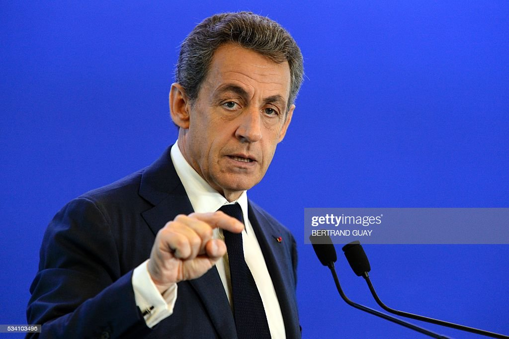France's right-wing Les Republicains (LR) party president Nicolas Sarkozy gestures as he delivers a speech focused on the social protection and health on Mai 25, 2016, in Paris. / AFP / BERTRAND
