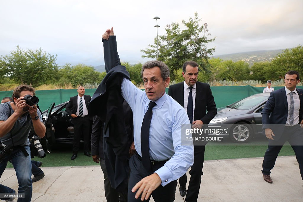 France's right-wing Les Republicains (LR) party president Nicolas Sarkozy arrives for a meeting with local heads of the party, on May 27, 2016 in Saint-Paul, on the French Indian ocean island of La Reunion. / AFP / RICHARD